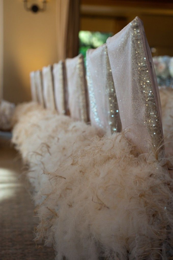Super cute blush tulle chair back w/ marilyn feather champagne chair skirt! Photo credit - @Michelle DeVoll Photography
