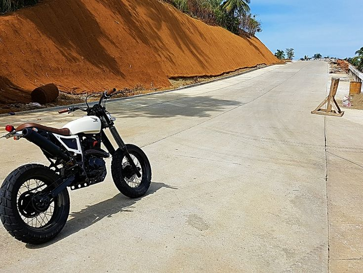 """This XR200 scrambler, built by 3B Customs of Surigao City, Philippines, was built for professional surfer Luke Landrigan, a huge moto enthusiast. The """"3B"""" in 3B Customs stands for Bikes Builds Bonds -- now that's [...]"""