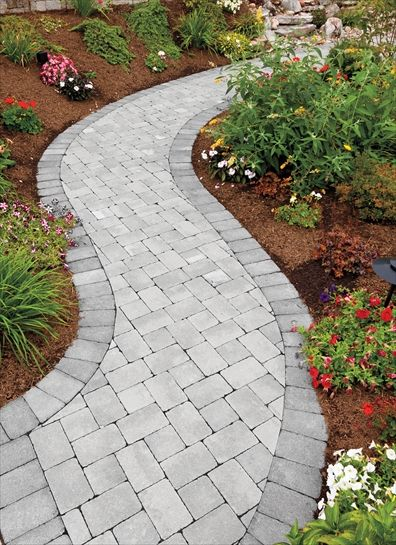"Small spaces appear larger when walkways are curvy. EP Henry pavers in Coventry® Stone I, Pewter Blend, ""I"" Pattern"