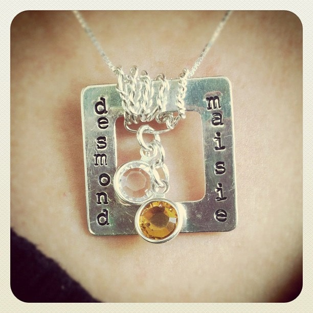 Silver mom necklace with hand stamped sterling silver square charm with child names and choice of Swarovski crystal birthstone charms. $40.00, via Etsy.