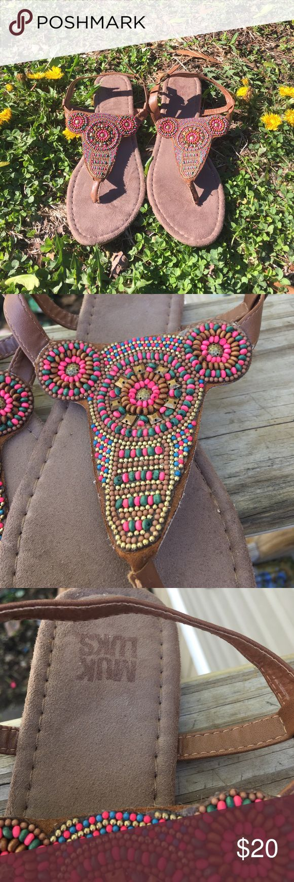 Size 9 Muk Luk beaded sandals Beautiful beaded sandals, only worn once but they are to small for me. I'm normally a 9 1/2. Would look great with jeans, shorts, dress or maxi skirt! Muk Luks Shoes Sandals