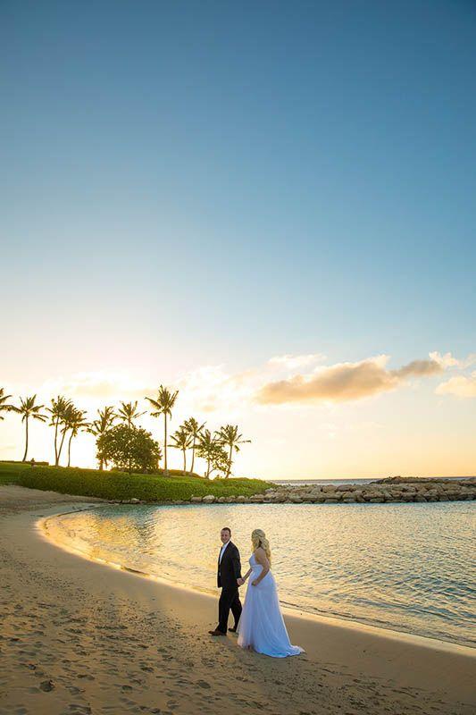 This wedding portrait is a Hawaiian dream at Disney's Aulani Resort.