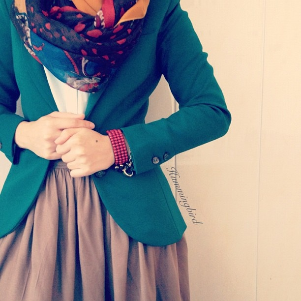 Love this color combination and style. Beautiful deep green with pops of brightness in the scarf!