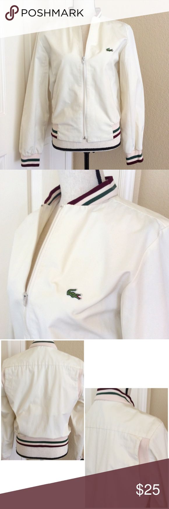 Vintage Lacoste bomber jacket 80's -maybe early 90's Cream Bomber style Windbreaker. Great condition. Has two little spots on bottom inner sleeve, pretty confident they will come out in wash. Men's size S, will fit a woman M comfortably. I will add measurements :) Lacoste Jackets & Coats