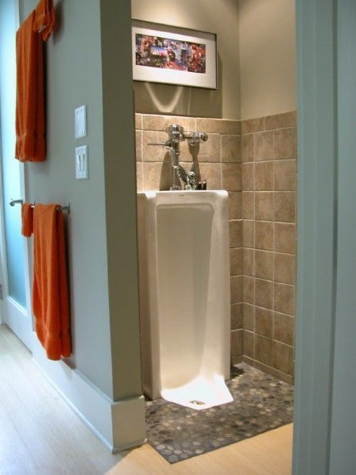 Don't forget the full length urinal in your bathroom man cave.