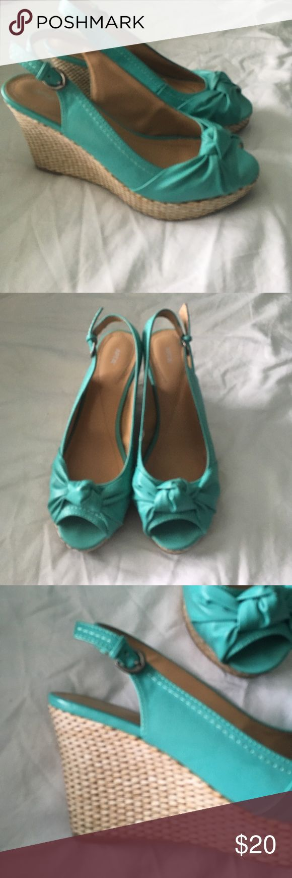 Turquoise wedges Turquoise wedges with cute design on toes. Open heel and toe with adjustable strap around the heels. Only worn twice. Still in great condition! Shoes Wedges