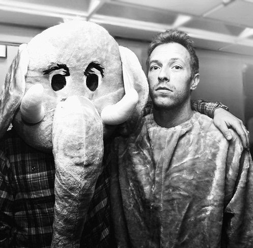 Chris Martin. I genuinly admire his outlook on life, talent, and fantastic brain. He's amazing :)