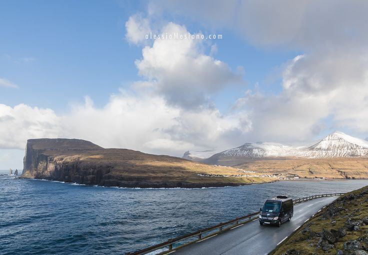 Alessio Mesiano posted a photo:  Public transport van on its way to the village of Tjørnuvík. In the background the village of Eiði and the Risin og Kellingin sea stacks. Faroe Islands