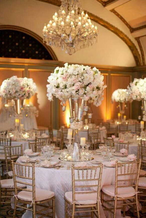Gorgeous floral centerpieces at this uplighting wedding