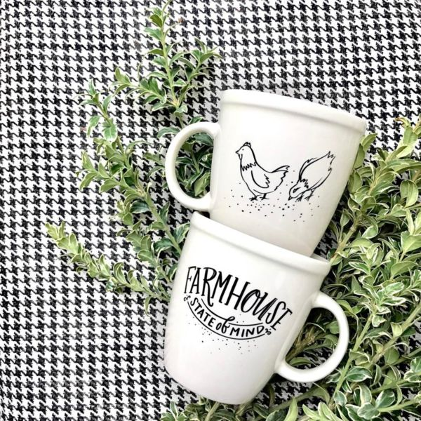 "Farmhouse State of Mind  about this mug Whether you spend most of your days in a bustling city, tucked in a suburb, or livin' the country life, all it takes is a simple cup of something yummy in your Farmhouse mug to take you to a daydream full of shiplap and farm life. No matter where you hang your hat, we can all be in a ""Farmhouse state of mind"" with this adorable mug. (We especially love the adorable little chickens on the back!) details     • 18 oz. glossy, natural-colored..."