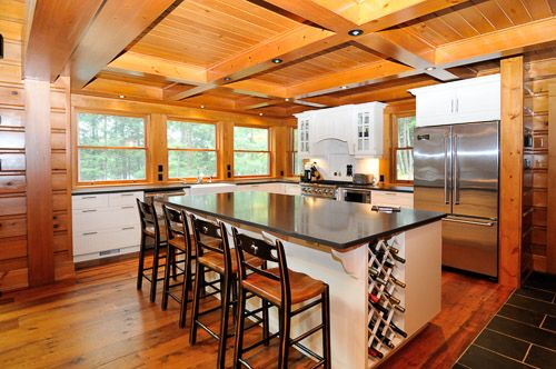 Stunning architectural design with vaulted ceilings, built in pot lights, 100 year old reclaimed hemlock floors, stone fireplace and floor to ceiling windows capturing the amazing southwesterly views at this vacation retreat.  www.cottagerental.com/cottages/543