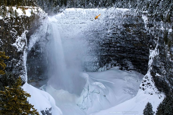 Helmcken Falls winter time.  The helicopter provides a scale reference point.