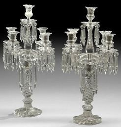 Pair Of English Victorian Five-Light Cut Glass Candelabra With A Petal-Form Cut Fluted Base Supporting A Tapering Standard Cut In The Honeycomb Pattern, With Four Flute-Cut Scrollet Branches, Holding Honeycomb-Cut And Tulip-Shaped Candle Cups With Matching Drip Pans, Hung With Cut-Glass Spear-Point Prisms, The Central Candle Cup Raised On Another Honeycomb-Cut Standard Cut To Match  -  English   c. 1875-1900  -  Prices4Antiques