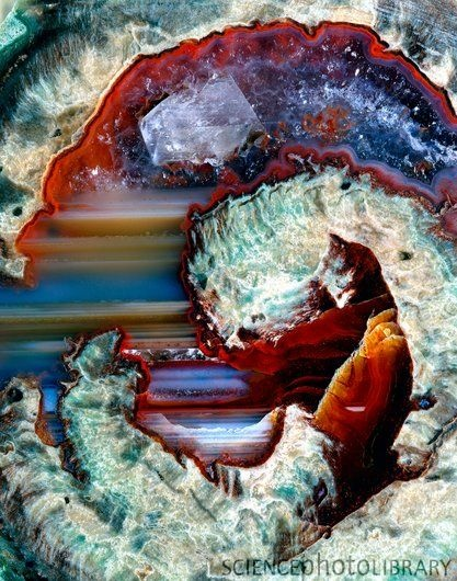 Rhyolitic geode / Rhyolite (green), Chalcedony (blue- white) and Hematite (red)