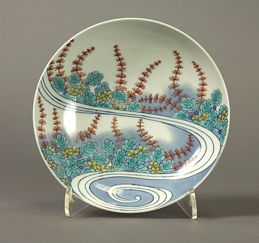 Dish with Design of Water Plants Period: Edo period (1615–1868) Date: early 18th century Culture: Japan Medium: Porcelain with underglaze blue and overglaze enamels (Hizen ware, Nabeshima type) Dimensions: H. 1 7/8 in. (4.8 cm); Diam. 5 7/8 in. (14.9 cm) Classification: Ceramic
