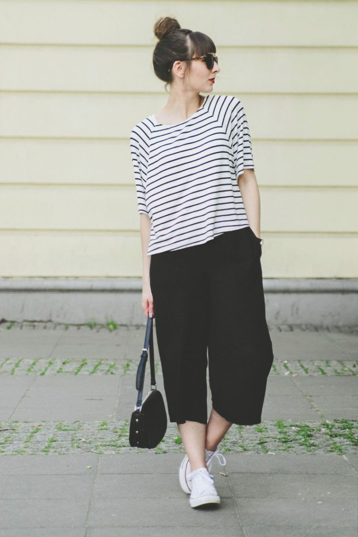 black culottes with narrow striped cropped top and white sneakers