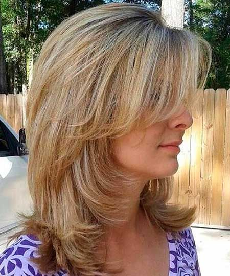 12. Medium Length Hairstyle with Bangs and Layers