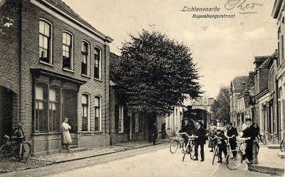 The Rapenburgsestraat street in Lichtenvoorde, province Gelderland. Vintage postcard from Trace Your Dutch Roots, a genealogy and heritage blog by Henk van Kampen.