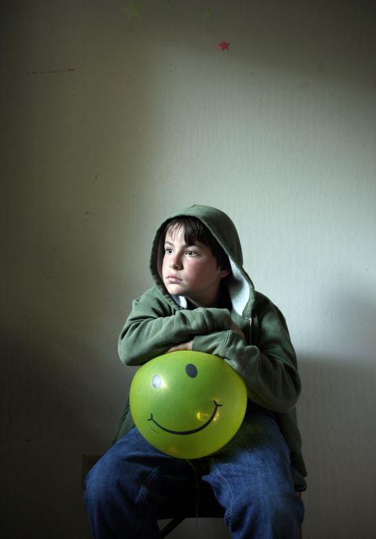 "timothy archibald, ""Echolilia: A Father's Photographic Conversation with his Autistic Son"". redux pictures.  I wanted an image that touched on clinical depression in children, or maybe something that represented a general mood disorder. The smiley balloons were a natural prop, but Eli's mile-long stare is what held the image together and gave it its soul (....)  http://lightbox.time.com/2010/10/25/echolilia-a-fathers-photographic-conversation-with-his-autistic-son/#6"