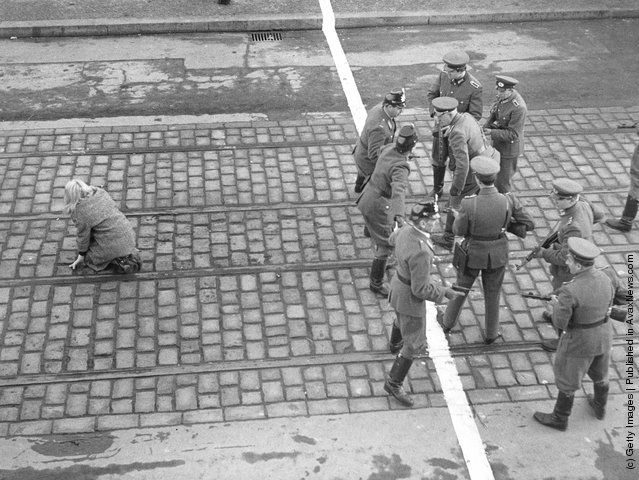 West Berlin policemen and East German Volkspolizei face each other across the border in Berlin, circa 1955. (Photo by Three Lions/Hulton Archive/Getty Images)