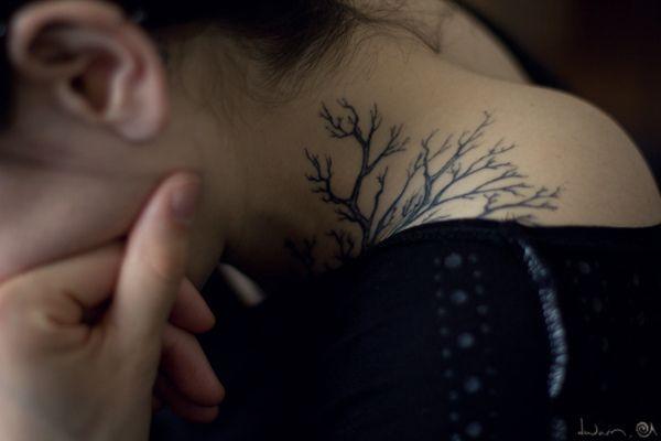 Neck tattoo tree growing