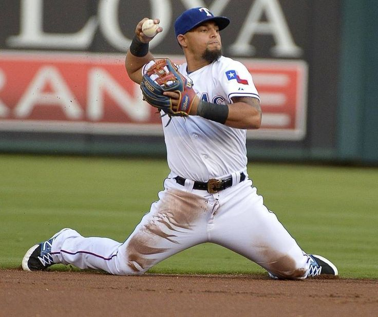 Texas Rangers second baseman Rougned Odor (12) tries to throwout Houston Astros second baseman Jose Altuve (27) at first base during the first inning as the Houston Astros play the Texas Rangers in MLB at Globe Life Park in Arlington, TX, Monday, Aug. 3, 2015.