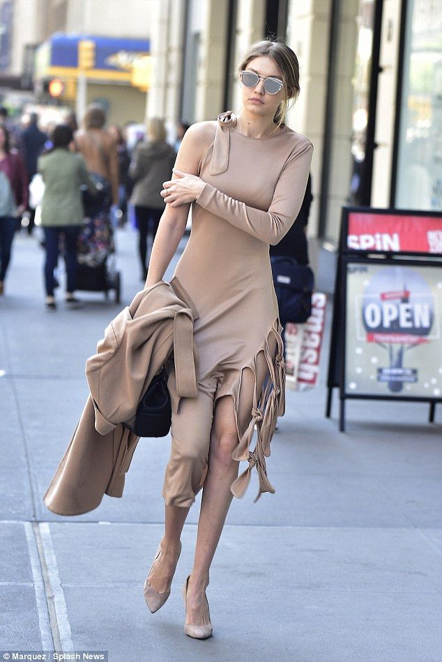 Gigi Hadid flaunts her model curves in tight beige dress that's slashed at the hip   Daily Mail Online