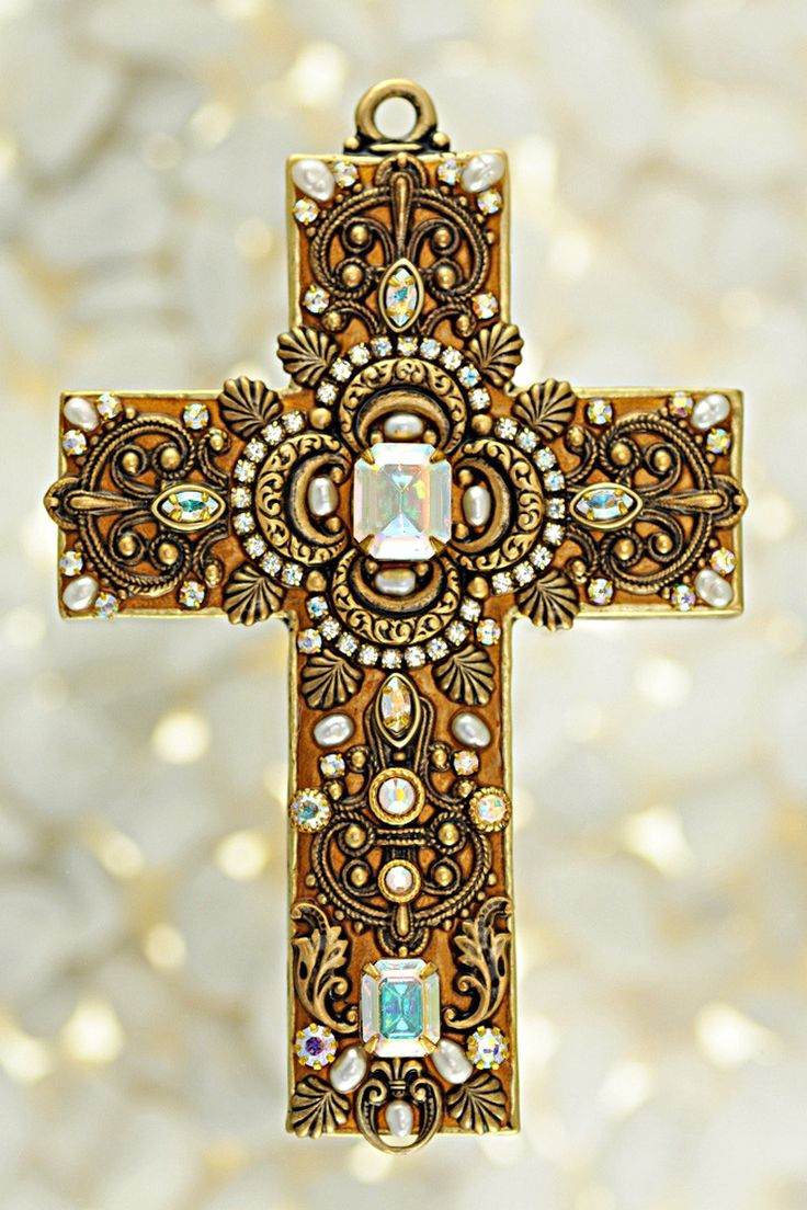 Classy and luxurious, this gemstone wall cross is adorned with freshwater pearls and Swarovski® crystals. The exquisite design is rich in both splendor and sparkle. Add this distinctive cross to your