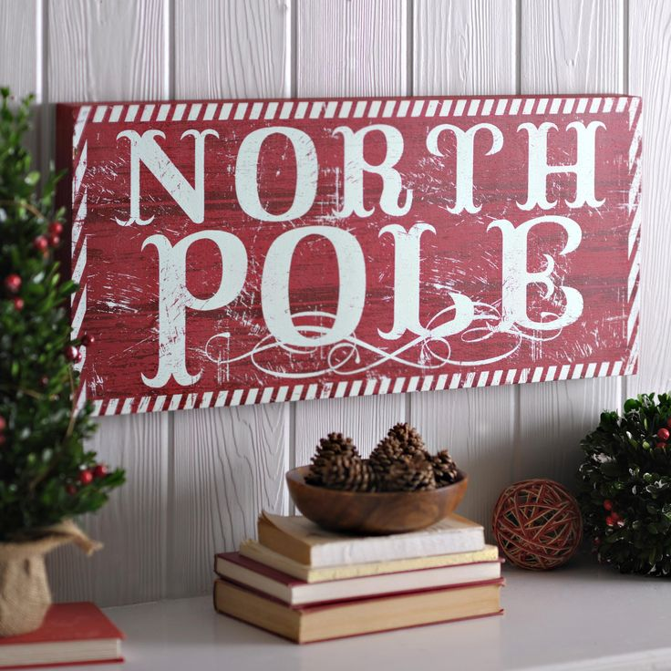 Bring the festive home of Santa to your home with the Distressed Red North Pole Wooden Sign. Hang it on a prominent wall so that everyone knows they've arrived at the one and only Christmas destination!