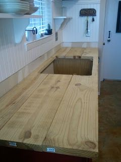 "Wow - DIY wood counter top.  Cheap!  Might be my favorite counter top option. Except glue together and sand before installing. Use 2"", 3"" or 6"" wide planks instead of 12""."
