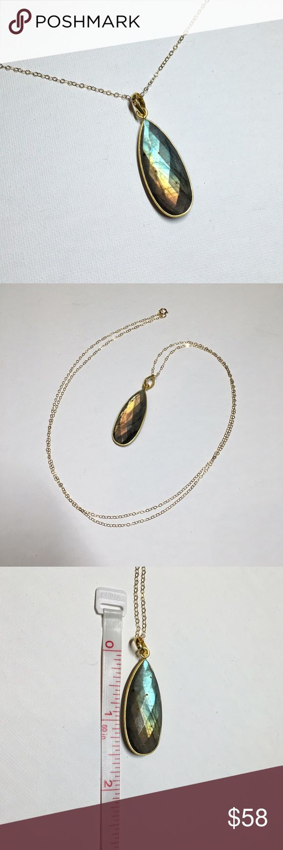 """Long Labradorite Teardrop Necklace in Gold Vermeil Large (~16x37mm) Labradorite teardrop wrapped in Sterling silver, then dipped in gold vermeil, dangling from a gold filled 30"""" chain. Labradorite is one of my favorite natural stones because it looks gray at some angles, but has a metallic Schiller (labradorescence) on both sides. There are 3 necklaces available and I will try to replace the photos after each one sells so that you can see the exact necklace you'll receive. Each one was hand…"""