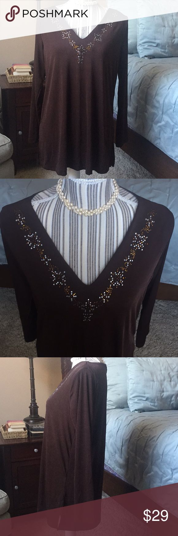 Gorgeous brown tunic with jeweled neckline This is a gorgeous piece that is subtle yet absolutely stunning at the same time. This would go well with jeans or a nice skirt or slacks. It's a very well-rounded versatile piece. Beautiful for a holiday party or just for every day wear. Great for layering warmth under a winter jacket. Used but great condition. Small. By Carolyn Strauss Collection. Pearl necklace not included. Carolyn Strauss Collection Tops Tunics