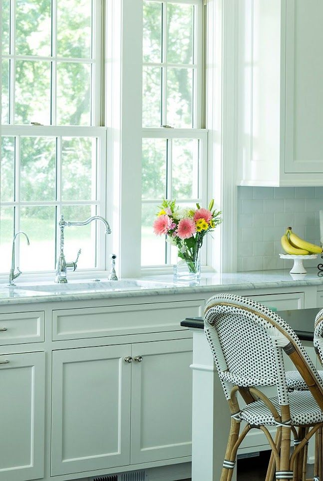 """Kitchen Sink and Faucet. The single control kitchen faucet with side spray in polished chrome was sourced by Pipeline Supply Inc. in Hopkins, MN. countertop is white granite, """"Bianco Gioia"""""""