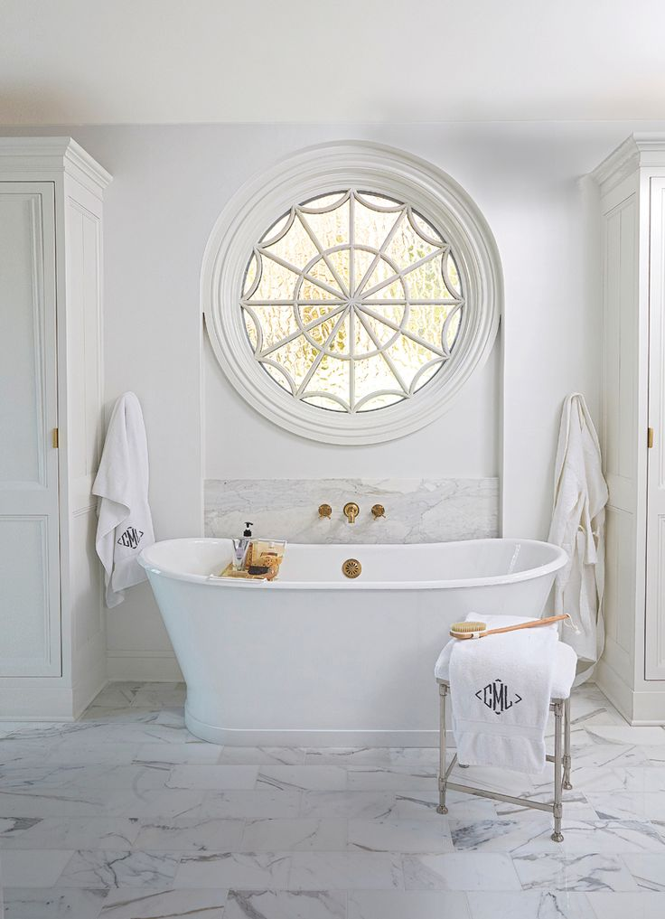 Marble bathroom with brass fixtures. #master #bathroom #design Love that window!