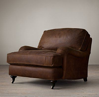 RH's English Roll Arm Leather Chair:Setback rounded English arms and large loose cushions on the angled back give English Roll Arm a relaxed feel.