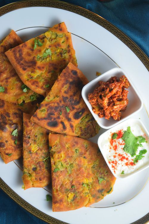 Peas and Corn Stuffed Parantha (stuffed Indian flatbread) is a delicious #meatless option! Serve with fresh yogurt and pickles. NaiveCookCooks.com