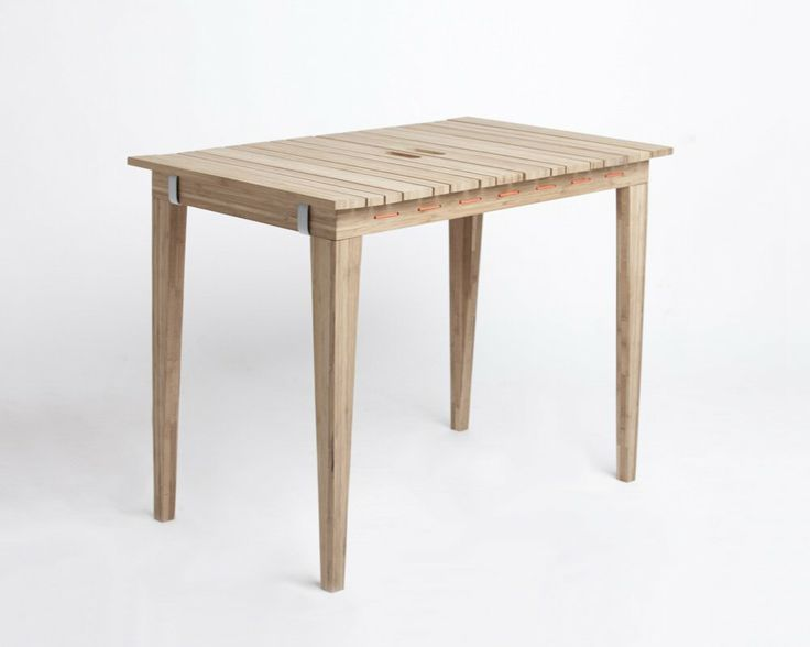 DryUnder (Anne Nørbjerg & Sanne Kyed, 2012): a table made out of wood which transforms in a jiffy to a drying rack.