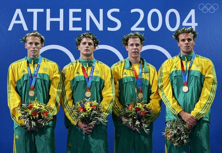 Olympic Gold medal for South Africa's swimming team 4x100m, Roland Schoeman, Lyndon Ferns, Darian Townsend and Ryk Neethling.