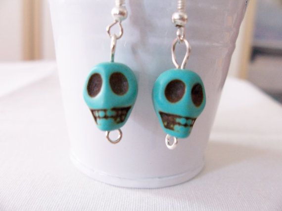 We carry several different colours of skull earrings! Stone or ceramic and finished with silver plated hooks.