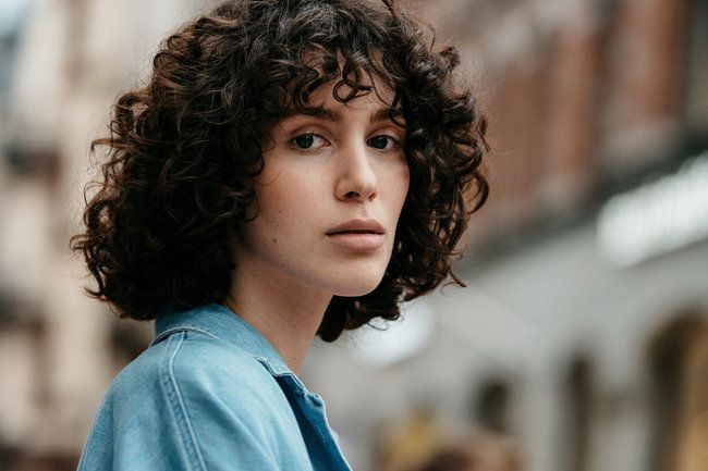 Street Style. Beautiful Curly Hair Cut from Fashion Week