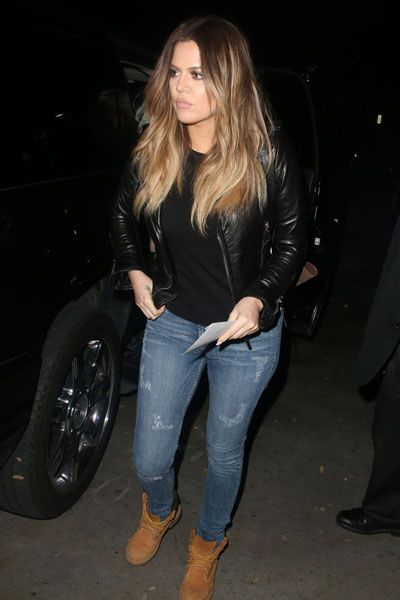 Khloe Kardashian is photographed leaving the Miley Cyrus concert wearing a leather jacket, distressed denim and Timberland boots.