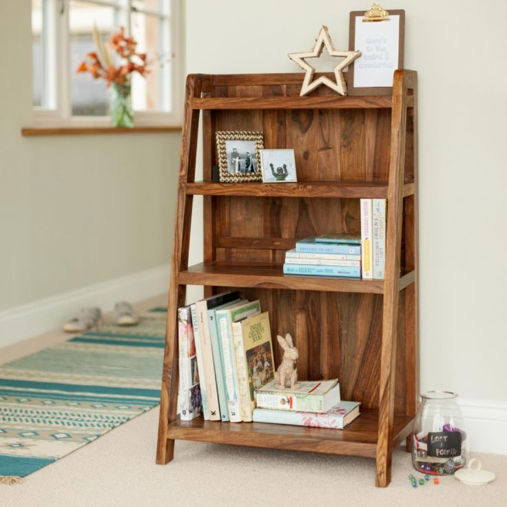 Mallani Small Compact Sheesham Ladder Bookcase is freestanding & has four fixed shelves that graduate in depth as they descend – the lower shelf being sized to fit large hardbacks and lever arch files