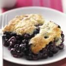 "Blueberry Biscuit Cobbler - 2c blueberries; .5c sugar; 2tbsp butter melted; 2/3c flour; 1.5tsp baking powder; 1/4tsp salt; 2/3c milk - put berries in greased 8"" baking dish;combine sugar & butter til crumbly;combine flour, BP & salt;add to sugar alternatively with milk; spread over berries;bake @ 350*F 40-45 min."
