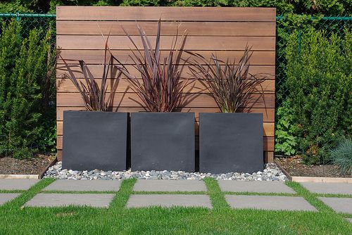 Love this! Soccer kicking wall on one side, beautiful planters on the other.