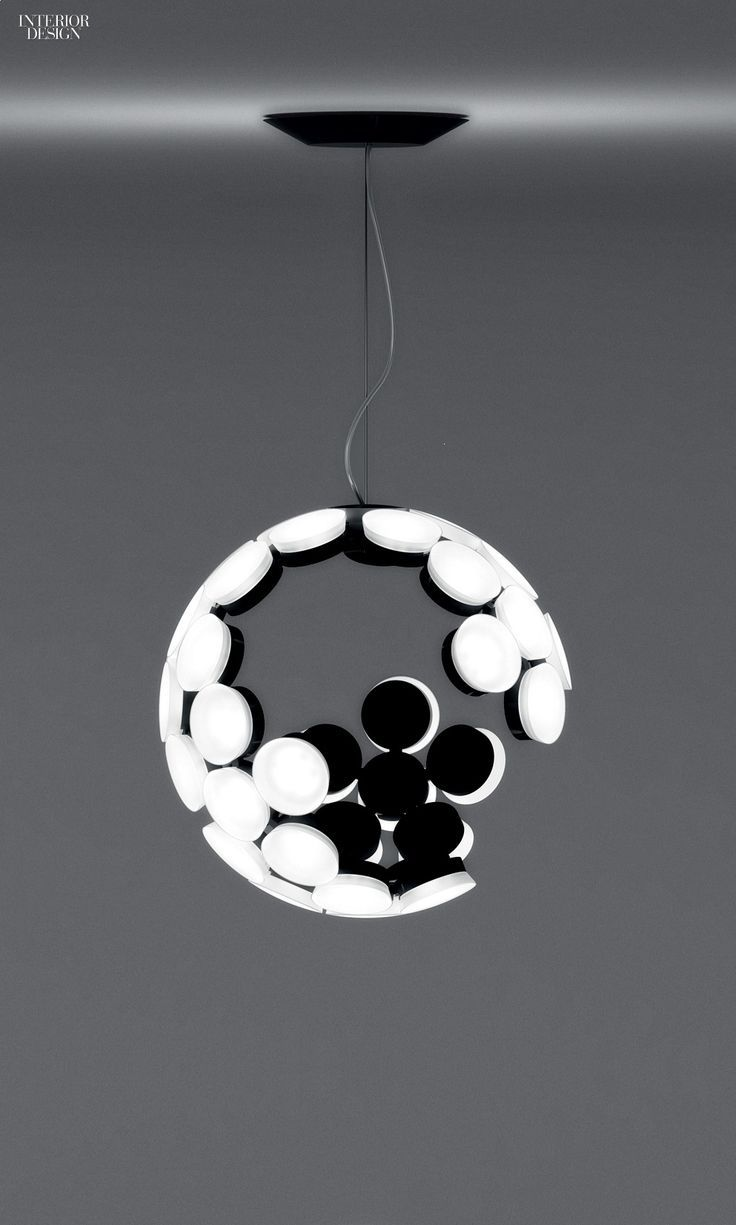 Neil Poulton's Scopas suspension lamp in painted aluminum by Artemide.