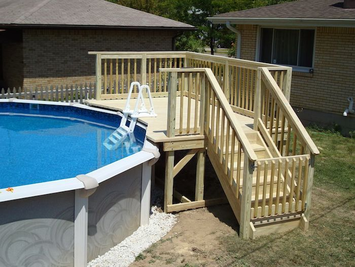 Staircase And A Small Deck Made From Pale Cream Colored Wood Next To A Garden Pool Small Above Ground Pools H Pool Deck Plans Luxury Pool Deck Simple Pool