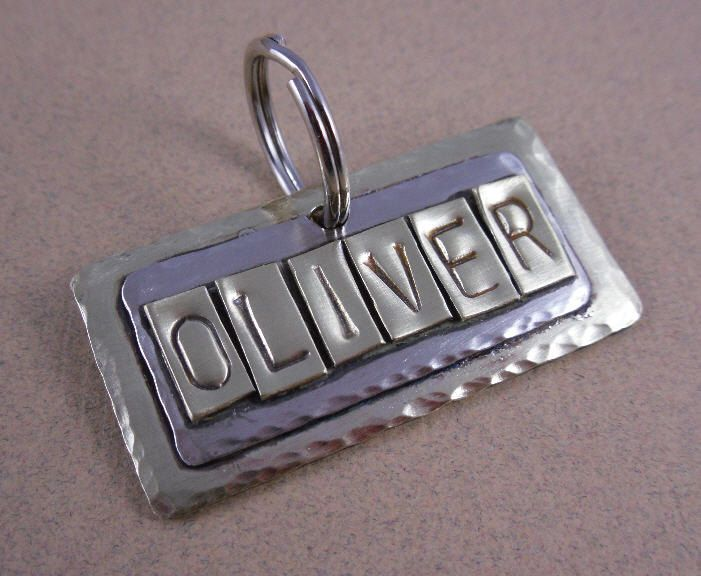 Pet Tag - Personalized Dog Tag - Sturdy Brass and Silver Mixed Metals Pet ID Tags. $16.95, via Etsy.