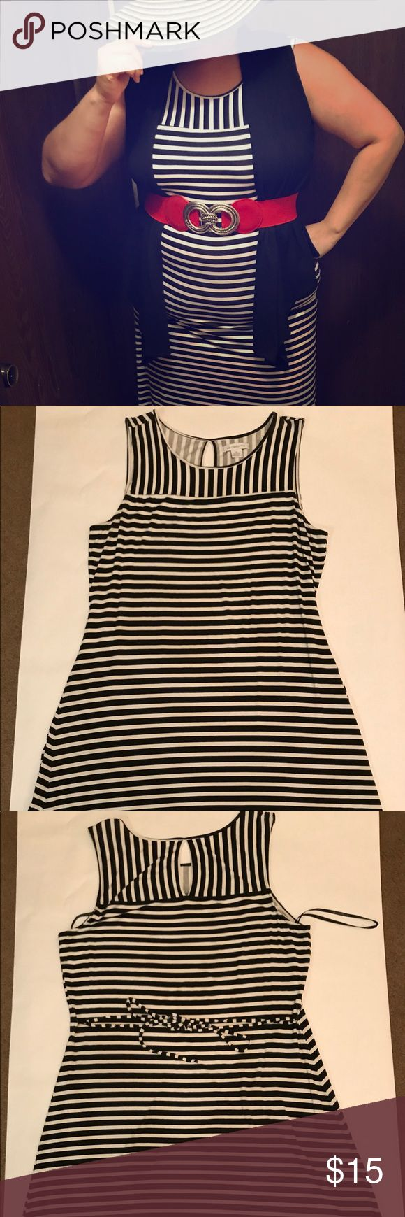 """Liz Claiborne Black &White Stripe 👗 Gently used Liz Claiborne White and Black Horizontal Sleeveless Dress.   Super Cute Spring Dress 👗 can dress it up a bit or wear as is.   Very stretchy - definitely a dress that hugs all the curves and highlights the body.   Size XL  Material: 95% Rayon 5% Spandex  Measurements: Armpits to the bottom 29"""" Back of the dress to the bottom 37"""" Front of the dress right down the middle 35"""" Liz Claiborne Dresses"""