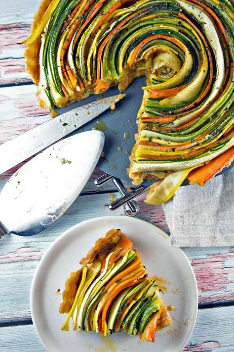 Thinly sliced summer vegetables are the visual star of this spiral vegetable tar…