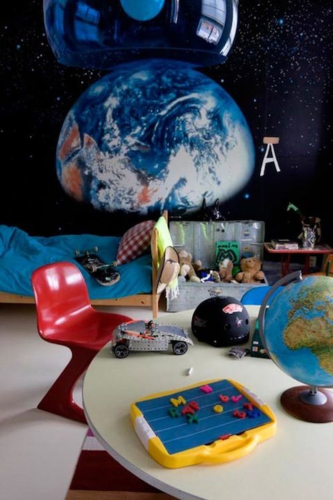 This Outer Space themed room has a bit of added hipness with the kid-sized retro chair.